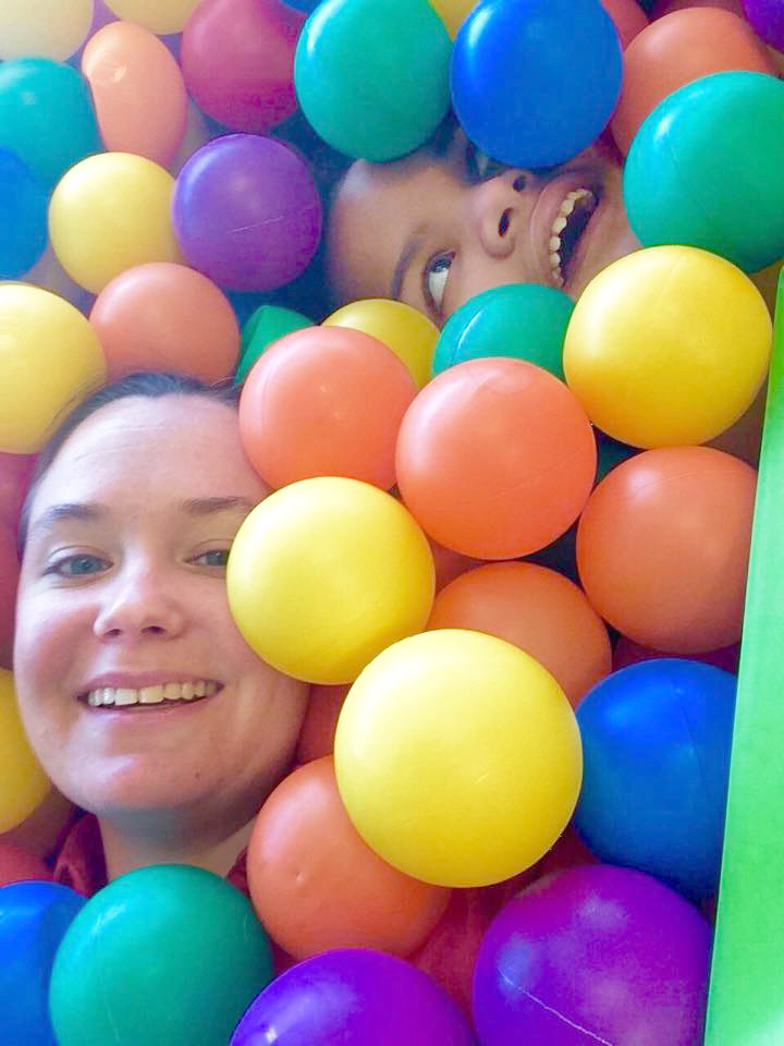 A speech therapist and her client in the ball pit